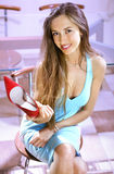 Shopaholic with red shoe. Happy woman shopaholic with red shoe in shopping mall royalty free stock image