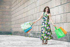 Shopaholic. Shopping love. Beautiful happy woman with bags. Stock Photos