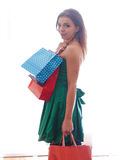 Shopaholic shopping woman. Shopper. Shopaholic shopping woman holding many shopping bags excited Stock Image