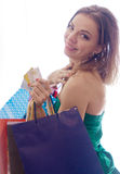 Shopaholic shopping woman. Shopper. Shopaholic shopping woman holding many shopping bags excited Stock Images