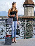 Shopaholic standing with shopping bags. Photo of a beautiful young woman standing with shopping bags, in Luzern Switzerland Stock Images