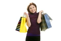 Shopaholic woman with colorful bags over white Stock Photography