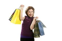 Shopaholic woman with colorful bags over white. Shopaholic woman shopping with colorful bags isoalted on white Stock Photo