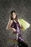 Shopaholic woman colorful bags retro Royalty Free Stock Photos