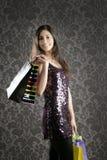 Shopaholic woman colorful bags retro wallpaper Royalty Free Stock Image