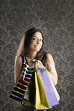 Shopaholic woman colorful bags retro wallpaper Royalty Free Stock Photo