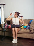 Shopaholic woman and her wardrobe. Young hipster woman sorting her wardrobe. Toned image Stock Images