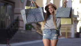Shopaholic woman holding many shopping bags stock video