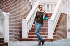 Shopaholic woman holding shopping bags Stock Photos