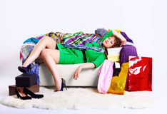 Shopaholic woman with purchases Royalty Free Stock Photo