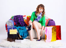Shopaholic woman with purchases Royalty Free Stock Photography