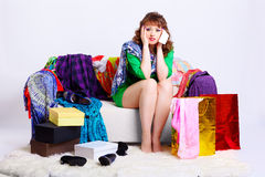 Shopaholic woman with purchases Stock Photo