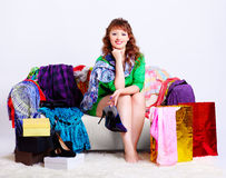 Shopaholic woman with purchases Stock Photography