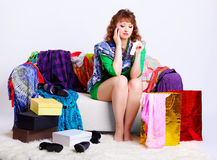 Shopaholic woman with purchases Stock Images