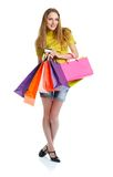 Shopaholic woman with shopping bags and credit card over white b Royalty Free Stock Photos