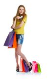 Shopaholic woman with shopping bags and credit card over white b Royalty Free Stock Images
