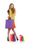 Shopaholic woman with shopping bags and credit card over white Royalty Free Stock Image