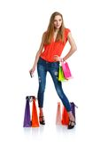Shopaholic woman with shopping bags and credit card over white Royalty Free Stock Photography
