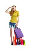 Shopaholic woman with shopping bags and credit card over white Royalty Free Stock Images