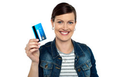 Shopaholic woman showing cash card Royalty Free Stock Photography