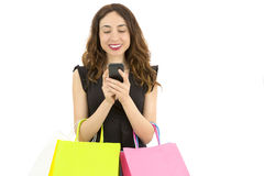 Shopaholic woman with a smart phone Royalty Free Stock Photos