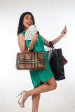 Shopaholic woman spending money and credit card for branded item Stock Photos