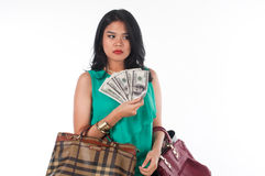Shopaholic woman spending money and credit card for branded item Royalty Free Stock Photography
