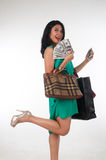 Shopaholic woman spending money and credit card for branded item Stock Photography
