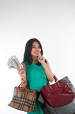 Shopaholic woman spending money and credit card for branded item Stock Photo