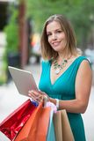 Shopaholic Woman With Tablet PC Royalty Free Stock Photos