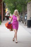 Shopaholic Woman Using Cellphone Royalty Free Stock Photo