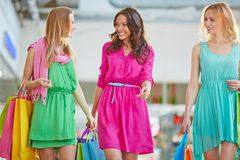 Shopaholics with paperbags Royalty Free Stock Images