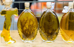 Shopboard with bottles puring virgin olive oil with  rosemary Royalty Free Stock Images
