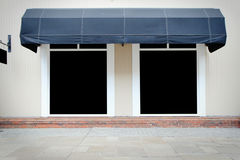 Shopfront vintage store front with canvas awnings Royalty Free Stock Image