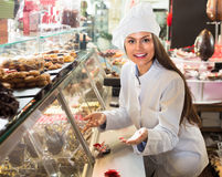 Shopgirl with chocolate and confectionery Royalty Free Stock Photo