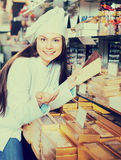Shopgirl with chocolate and confectionery Royalty Free Stock Photos