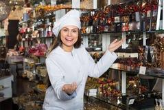 Shopgirl posing with chocolate Royalty Free Stock Photos