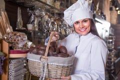 Shopgirl posing with chocolate eggs Royalty Free Stock Photos