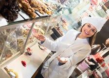 Shopgirl posing with chocolate Stock Photography