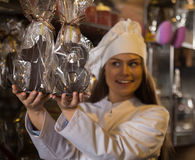 Shopgirl posing with chocolate numbers Royalty Free Stock Image