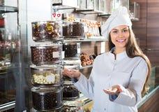 Shopgirl posing with chocolate Stock Photos