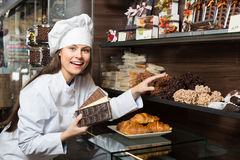 Shopgirl posing with chocolate Royalty Free Stock Photography