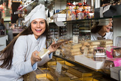 Shopgirl posing with chocolate Royalty Free Stock Image