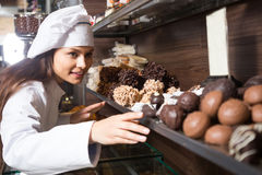 Shopgirl posing with delicious chocolate Stock Image