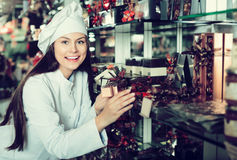 Shopgirl posing with delicious ganaches, praline and chocolates Stock Image