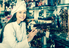 Shopgirl posing with delicious ganaches, praline and chocolates Royalty Free Stock Photography