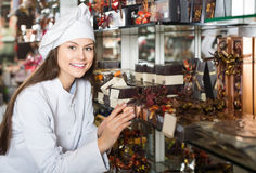 Shopgirl posing with delicious ganaches, praline and chocolates Stock Photo