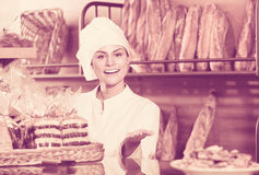 Shopgirl working in bakery Royalty Free Stock Image