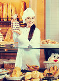 Shopgirl working in bakery Royalty Free Stock Photo