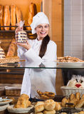 Shopgirl working in bakery Stock Photo